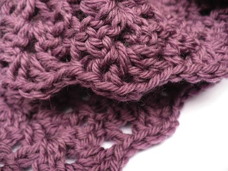 A crochet scarf in purple yarn